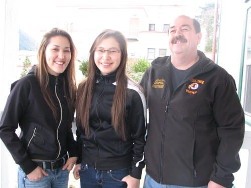 Renatta Olson, Joallyn Johnson, and Mt. Edgecumbe girls basketball coach Dane Vincent. (KCAW photo/Robert Woolsey)