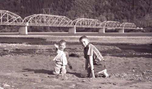Dennis Girardot (left) with his brother John Reitz (right) at the Knik River bridge in Palmer. Girardot was five year old when he and his family survived the Great Alaska Earthquake of 1964. (Photo courtesy of Dennis Girardot).