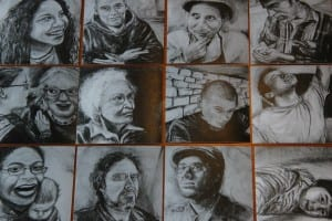 MacNaughton created a set of portrait trading cards from her work. (KCAW photo/Rachel Waldholz)