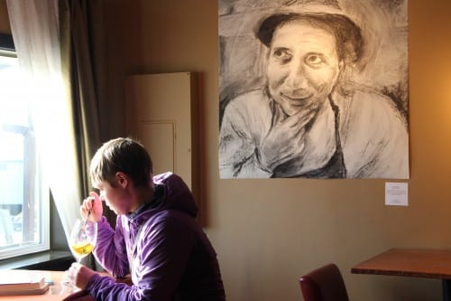 MacNaughton's portraits will be displayed at Rio's Wine Bar in Sitka through the end of May. (KCAW photo/Rachel Waldholz)