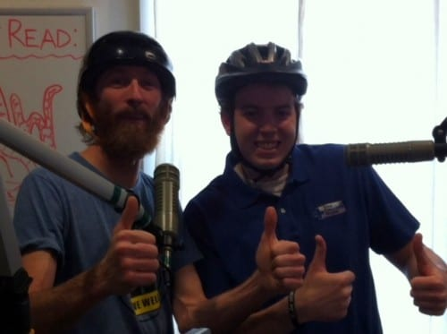 Ryan Kauffman and Patrick Williams encourage bike safety. (KCAW photo).
