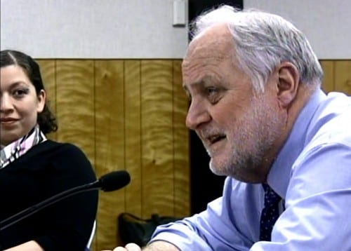 """As board member Tonia Rioux looks on, Superintendent Steve Bradshaw told assembly members to """"love every kid who walks down our streets."""" (Image courtesy KSCT-TV)"""
