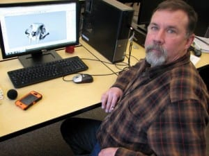 Kent Winship models a skull on CAD software, before printing in 3D. (KCAW photo/Robert Woolsey)