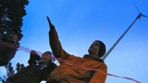 Mt. Edgecumbe science teacher Matt Hunter cuts the ribbon on the school's full-size turbine in 2010. (KCAW photo/Robert Woolsey)