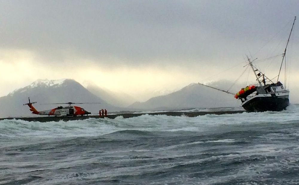 Two rescued as troller goes aground in heavy surf