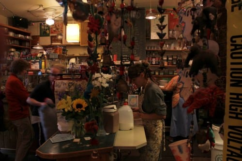 """""""This is people's office, home away from home, living room, den, social place,"""" says Jeff Budd, of the Backdoor Cafe. """"It is part of the social fabric here."""" (KCAW photo/Rachel Waldholz)"""