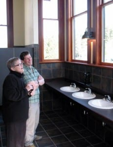 Carol Odess and Roger Schmitd take in the jaw-dropping view from the new women's restroom in Allen Hall. (KCAW photo/Robert Woolsey)