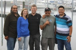 Leone and his wife, Ellen Leone, pose with his rescuers at the La Push Marina. From left, Darryl Penn, Ellen Leone, Lance Leone, Charlie Sampson and Levi Black. (Photo: Ed Ronco/KPLU)