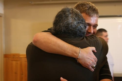 Lt. Lance Leone, right, hugs Darryl Penn, a La Push resident who helped rescue him from a helicopter crash. Leone visited La Push at the fourth anniversary of the July 7, 2010 crash. (Photo: Ed Ronco/KPLU)