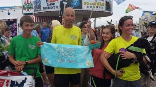 David Wilcox (l.), Brett Wilcox, Olivia Wilcox, and Kris Wilcox are greeted on the boardwalk in Ocean City, NJ, as they wrap up their 6-month, 3,000 mile run. (RunningTheCountry.com photo)