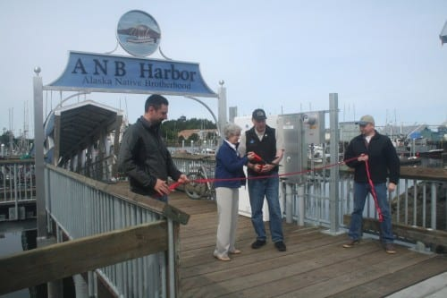 Local officials hold a ribbon cutting to celebrated the completion of the ANB Harbor rebuild. (KCAW photo/Greta Mart)