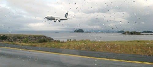 An Alaska Airlines jet touches down in Sitka. Both runway approaches are over ocean. (Flickr photo/Pat Groves)