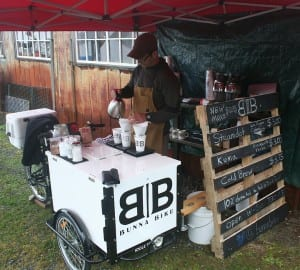 Chris Bryner brews direct-trade coffee at his new coffee cart in Sitka. (KCAW/photo by Greta Mart)