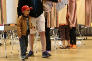 Matthew Lowe brought his son, Roland, to the polls on primary day. (KCAW photo/Rachel Waldholz)