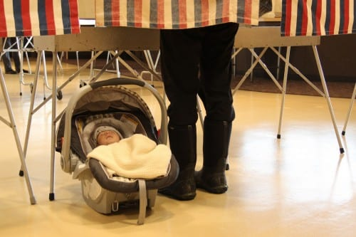 Maggie Gallin brought her son, Theo, to the polls on Tuesday, to vote in Alaska's primary election (KCAW photo/Rachel Waldholz)