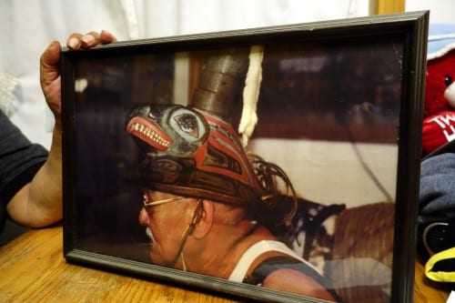 Albert Davis, Herman's older brother, wears the Coho clan hat. The object has been in the family for 300 years. (Emily Kwong/KCAW photo)