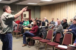 Permit-holders listen to ADF&G biologist Dave Gordon lay out how the 2015 herring fishery will work. This year's fishery is being conducted as a co-op, so far fewer fishermen are in town. (Rachel Waldholz/KCAW)