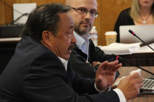 Simeon Swetsov, Jr., left, the mayor of St. Paul in the Pribilof Islands, choked up as he testified before the NPFMC advisory panel. Beside him is Mateo Paz-Soldan. (Rachel Waldholz/KCAW)