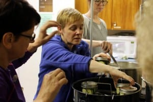 Sitka residents learn how to pickle and ferment fruits and vegetables at Sitka Kitch in mid-July. Pictured above, instructor Sarah Lewis of UAF's Cooperative Extension. KCAW photo/Vanessa Walker.