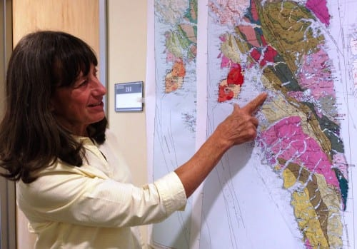 Geologist Susan Karl points to faults shown on a new geologic map of Baranof Island, in Southeast Alaska. It reflects the discovery that the island's bedrock is different from that of other parts of the region. (Ed Schoenfeld/CoastAlaska News)