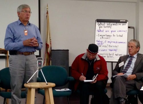 Lt. Gov. Byron Mallott speaks at a Wednesday tribal meeting in Juneau on transboundary mines. United Tribal Transboundary Mining Work Group Co-Chair Rob Sanderson Jr., center, and Fish and Game Commissioner Sam Cotten, right,  listen. (Photo by Ed Schoenfeld/CoastAlaska News)