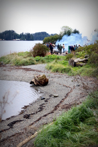 The steaming on Sitka's Eagle Beach attracted friends and family of the carvers along with Park Service employees. (KCAW Photo/Emily Russell)
