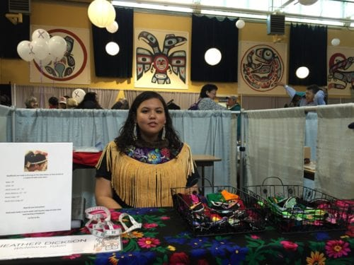 In less than a year, Whitehorse beader Heather Dickson has developed a booming online business, Dickson Design. It began when she converted floral handkerchiefs - worn by elders in the Yukon - into beaded headbands. (Emily Kwong/KCAW photo)