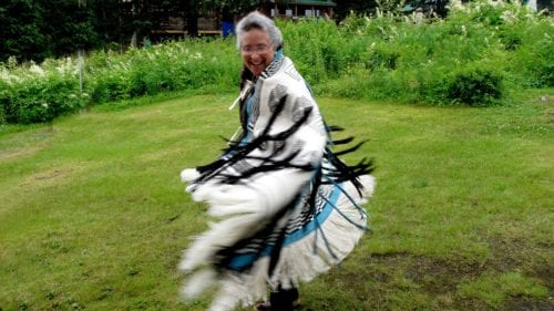 In a career spanning three decades, Teri Rofkar mastered the fiber arts of basketry and textile weaving. She is pictured here dancing in her daughter's Ravenstail Lituya Bay robe. Lituya Bay is the farthest back she can trace her family's history. (From Rofkar's Facebook page)