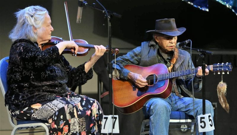 Yukon country singer Art Johns, 84, backed up by Skagway fiddler Nola Lamken, performs April 4, 2017, at the Alaska Folk Festival in Juneau. (Photo by Brian Wallace Photography)