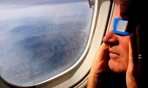 Never mind the rain, Sitkans take to the skies to view eclipse