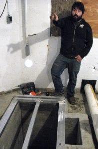 Blake Conaway, hatchery maintenance manager, explains plans for a recirculation system in the egg room. (Ed Schoenfeld/CoastAlaska News)