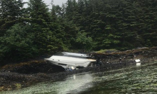 Overturned cabin cruiser stuck in Redoubt Bay
