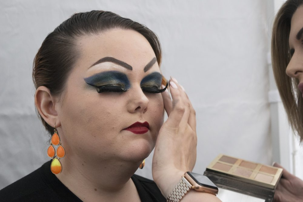 Jessica Henry has her makeup done before Sitka's first drag show. (Photo: KCAW/Katherine Rose)