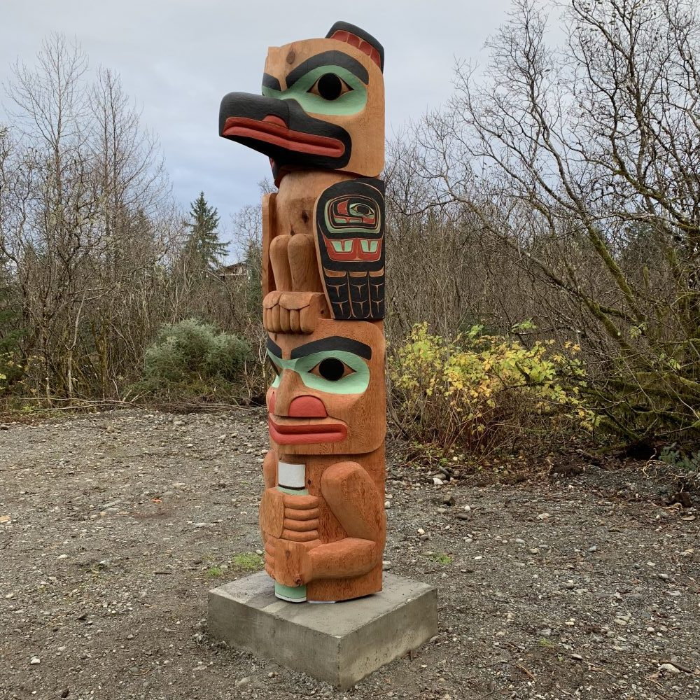 Alison Marks' first totem pole honors the memory of her grandfather, John Bremner Sr. of Yakutat, and depicts holding a thermos of coffee under a raven. (Photo courtesy of Allison Marks)
