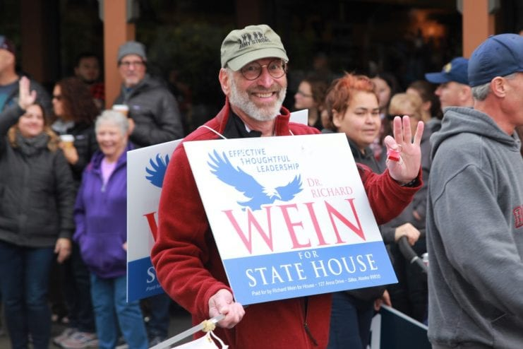 Republican challenger Richard Wein, pictured above on the campaign trail in the Alaska Day Parade in Sitka, ran against incumbent Democrat Jonathan Kreiss-Tomkins. (Photo by Enrique Pérez de la Rosa)