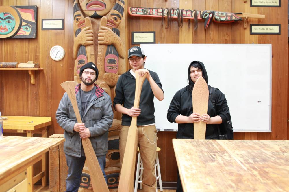 Students from Pacific High School travel to Sitka National Historical Park's visitor center every Friday to learn traditional carving techniques from artist Mark Sixbey. From left to right, senior David Abril, sophomore David Bean and sophomore Eric Alvarado pose with the paddles they have carved.
