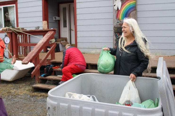 Tribal council chair KathyHope Erickson stops by the Kaa Toowú Náagu Hídi to collect some bags of herring eggs. (KCAW photo / Enrique Pérez de la Rosa)
